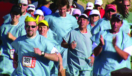 Near the end of the race Team Tumor donned hospital gowns and crossed the finish line with their final runner, Dov Siporin.