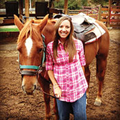 Editor Jenny Willden with a horse at a Colorado Dude ranch