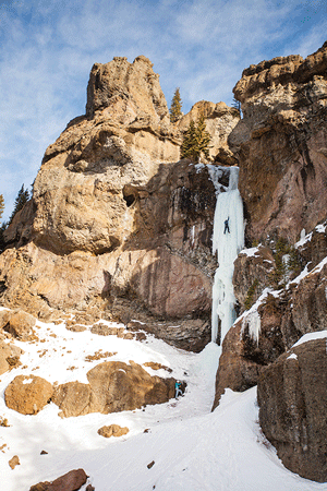 Julie Ellison photographs a climber on The Scepter in Hyalite Canyon