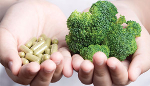 Photo of broccoli and vitamin pills