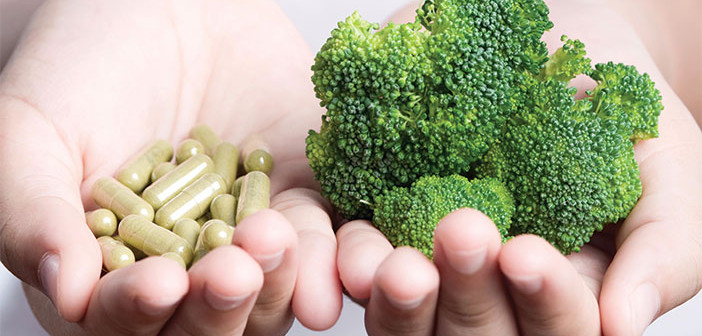 Photo of broccoli and vitamin pills