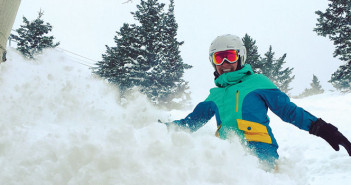 Editor Jenny Willden snowboarding in powder
