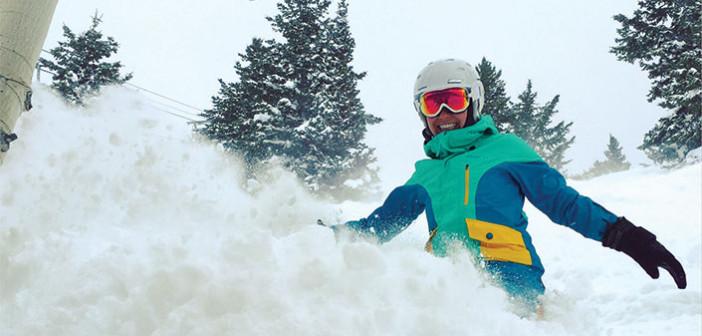 Editor Jenny Willden snowboarding in powder