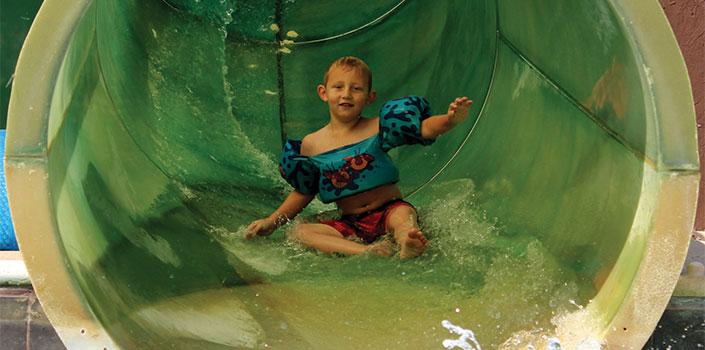 Child on hot springs water slide