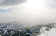 Skier in action with a scenic backdrop