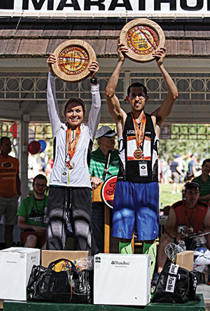 St. George Marathon winners Amber Green and Aaron Metler hold their trophies