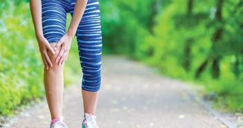 A runner holding her knee