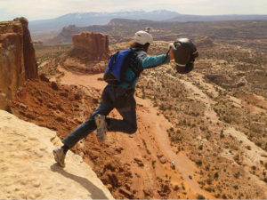 moab BASE jumper starting his jump from a cliff