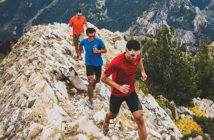 3 male Fall trail runners in the Utah Mountains