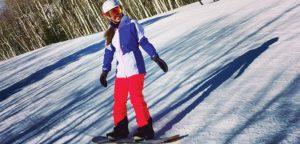 Editor Jenny Willden snowboarding