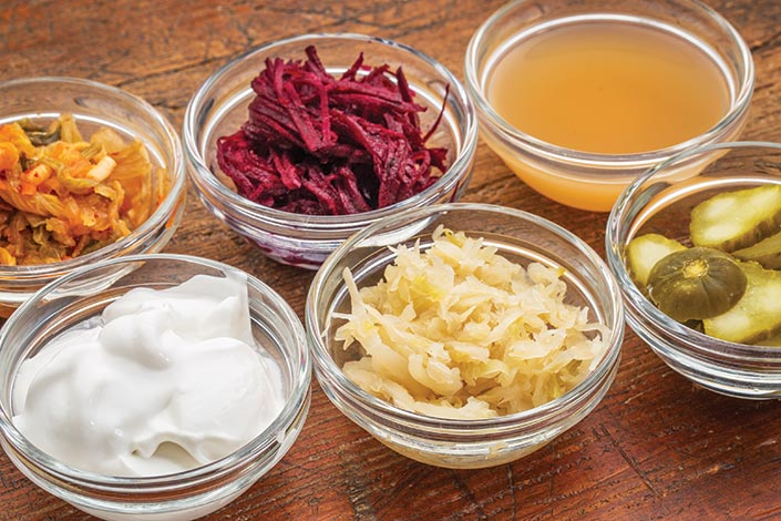 Bowls with multiple probiotic foods on a table