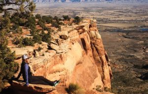 Jenny Willden sitting on a overlook