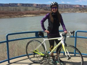 Jenny Willden near a river with a bicycle