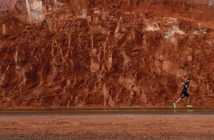 Runner against a red rock background