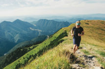 Man running on a mountain trail