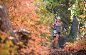 Woman running on a forest trail