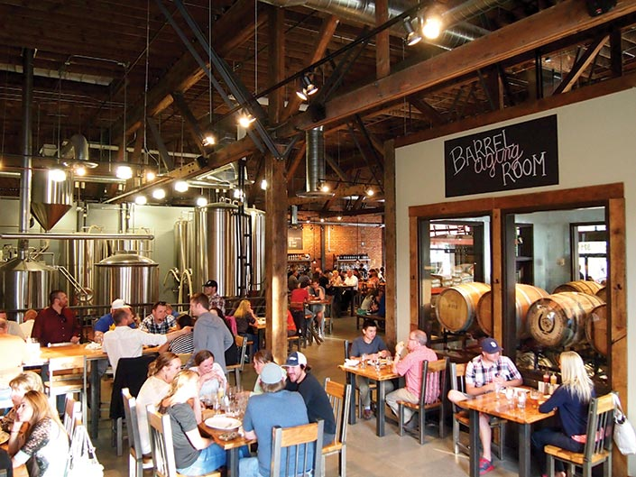 Group of people enjoying beers at the 10 Barrel brewery