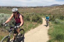 A woman and man biking on a trail in Boise Idaho