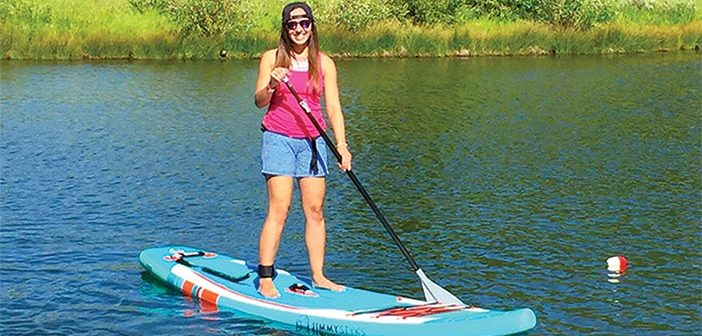 Editor Jenny Willden paddle boarding on a lake