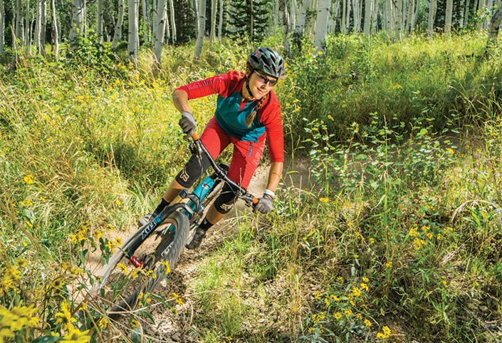 Woman mountain biking at Deer Valley Resort