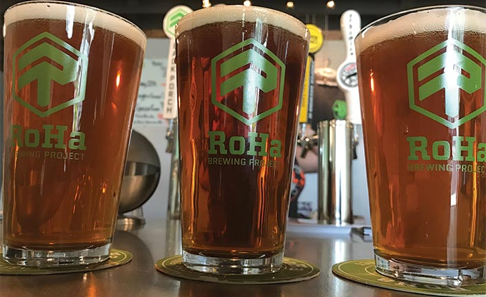 Roha Brewery pint glasses with beer