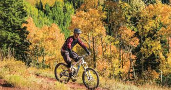 Mountain biker on a trail in the fall mountains