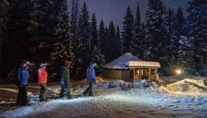 Grouping walking at night near The Yurt at Solitude