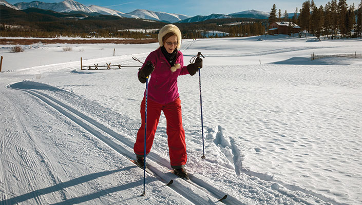 Woman in red cross country skiing