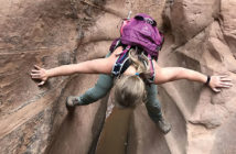 Woman Stemming down a narrow drop in Dang Canyon.