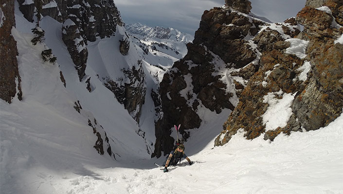 Skier hiking up a chute