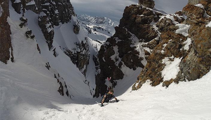 Skier hiking up a chute