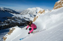 Woman skiing on powder snow