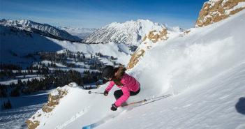 Woman skiing on powder snow
