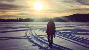 Person Walking across frozen Grand Lake.