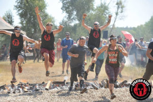 Author Nick Como leaping the fire at the Spartan finish line