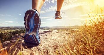 A trail runner's feet and legs