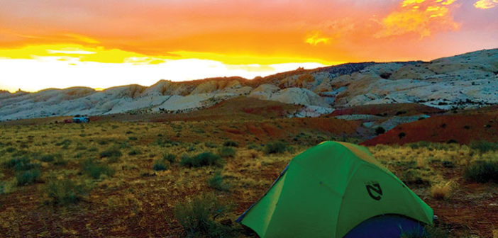 Tent in wilderness with sunset