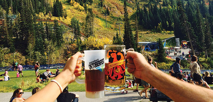 A beer cheers in the mountains during oktoberfest