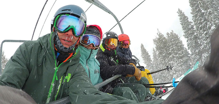 A family of skiers on a ski lift
