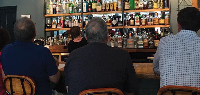 Men sitting at the bar at Kerouac's