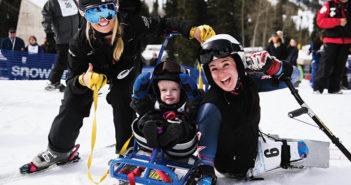 Anna Beninati working with kids for Wasatch Adaptive Sports.