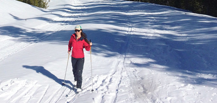 Melissa McGibbon cross-country skiing on snowy trail