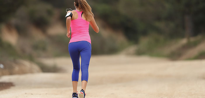 Woman running on a dirt trail long-Distance Running Training