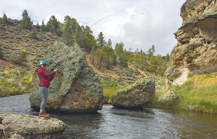 Jenny Willden Reeling in a trout at Mammoth's Hot Creek.