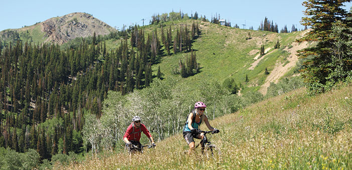 Man and Woman mountain biking at Park City, Utah