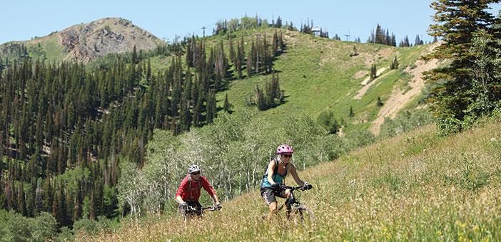 Man and Woman mountain biking at Park City, Utah