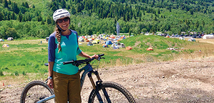 editor Jenny Willden with mountain bike on a trail