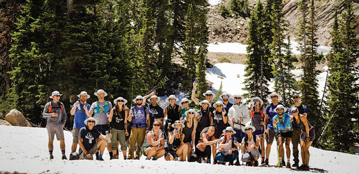 group of adult campers hiking at Snowbasin