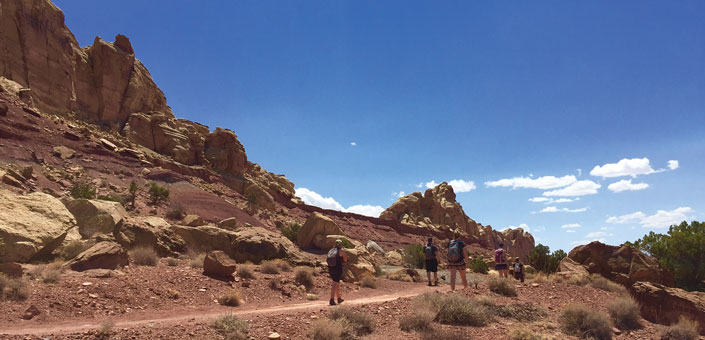 San Rafael Swell landscape and hikers
