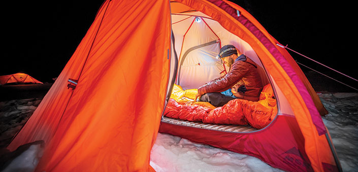 man in tent winter camping.